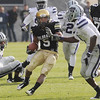 "Rodney Stewart of Colorado looks for room to  run against Kansas State on Saturday.<br /> For more photos of the game, go to  <a href=""http://www.dailycamera.com"">http://www.dailycamera.com</a>.<br /> Cliff Grassmick / November 20, 2010"
