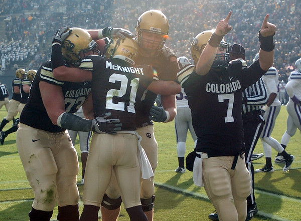 "Cody Hawkins points to his family in Dal Ward as teammates celebrate a Scotty McKnight TD.<br /> For more photos of the game, go to  <a href=""http://www.dailycamera.com"">http://www.dailycamera.com</a>.<br /> Cliff Grassmick / November 20, 2010"