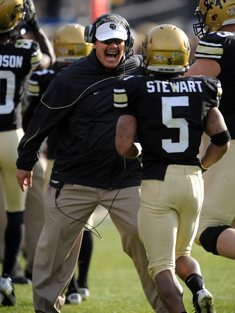 """University of Colorado interim head coach, Brian Cabral, prepares to hug Rodney Stewart after a CU touchdown against Kansas State in the November 20, 2010 game in Boulder.<br /> For more photos of the game, go to  <a href=""""http://www.dailycamera.com"""">http://www.dailycamera.com</a>.<br /> Cliff Grassmick / November 20, 2010"""