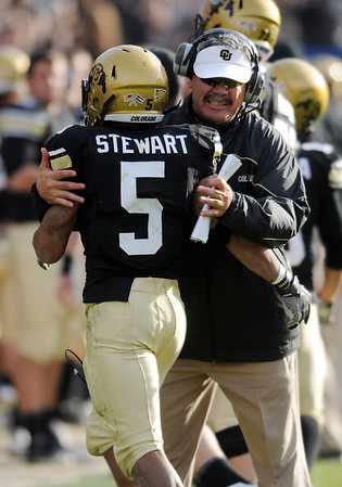 "Brian Cabral has a hug for Rodney Stewart after a CU touchdown against KSU.<br /> For more photos of the game, go to  <a href=""http://www.dailycamera.com"">http://www.dailycamera.com</a>.<br /> Cliff Grassmick / November 20, 2010"