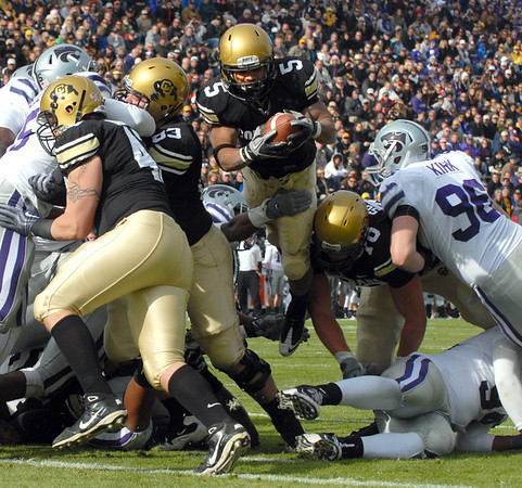 """Rodney Stewart of CU goes airborne to score against Kansas State.<br /> For more photos of the game, go to  <a href=""""http://www.dailycamera.com"""">http://www.dailycamera.com</a>.<br /> Cliff Grassmick / November 20, 2010"""