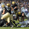 "Rodney Stewart of CU goes airborne to score against Kansas State.<br /> For more photos of the game, go to  <a href=""http://www.dailycamera.com"">http://www.dailycamera.com</a>.<br /> Cliff Grassmick / November 20, 2010"