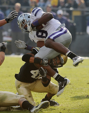 "Terrel Smith of Colorado makes the tackle on  Daniel Thomas of Kansas State in the November 20, 2010 game in Boulder. Colorado won 44-36.<br /> For more photos of the game, go to  <a href=""http://www.dailycamera.com"">http://www.dailycamera.com</a>.<br /> Cliff Grassmick / November 20, 2010"