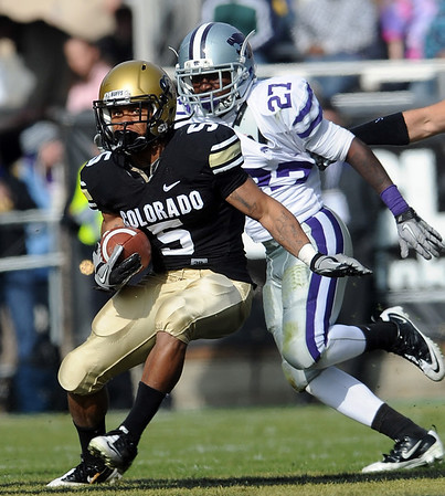 """Colorado's Rodney Stewart gets past David Garrett of Kansas State during the November 20, 2010 game in Boulder.<br /> For more photos of the game, go to  <a href=""""http://www.dailycamera.com"""">http://www.dailycamera.com</a>.<br /> Cliff Grassmick / November 20, 2010"""