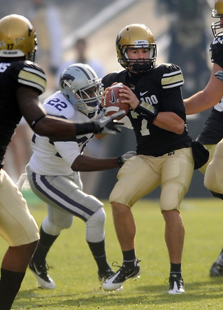 """CU's Cody Hawkins prepares to pass against KSU. Thomas Ferguson of Kansas State puts on the pressure during the November 20, 2010 in Boulder.<br /> For more photos of the game, go to  <a href=""""http://www.dailycamera.com"""">http://www.dailycamera.com</a>.<br /> Cliff Grassmick / November 20, 2010"""