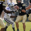 "CU's Cody Hawkins prepares to pass against KSU. Thomas Ferguson of Kansas State puts on the pressure during the November 20, 2010 in Boulder.<br /> For more photos of the game, go to  <a href=""http://www.dailycamera.com"">http://www.dailycamera.com</a>.<br /> Cliff Grassmick / November 20, 2010"