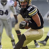 "Scotty McKnight takes a pass in for a touchdown against KSU.<br /> For more photos of the game, go to  <a href=""http://www.dailycamera.com"">http://www.dailycamera.com</a>.<br /> Cliff Grassmick / November 20, 2010"