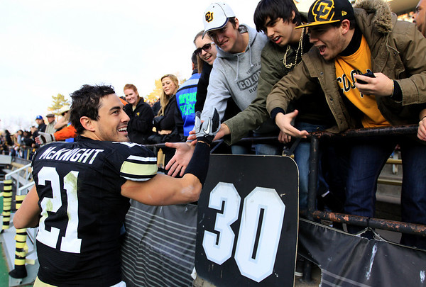 University of Colorado's wide receiver Scotty McKnight greets fans after the game against Kansas State at Folsom Field on Saturday. CU beat Kansas State 44-36.<br /> Saturday, Nov.  20, 2010. <br /> SAM HALL / Camera