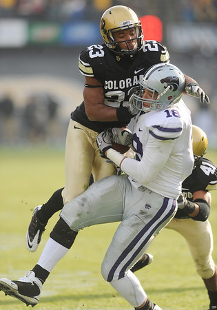 Jalil Brown of Colorado breaks up a pass for Andre McDonald of Kansas State during the November 20, 2010 game in Boulder.<br /> Cliff Grassmick / November 20, 2010