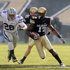 "Toney Clemons of Colorado looks for room against KSU on Saturday.<br /> For more photos of the game, go to  <a href=""http://www.dailycamera.com"">http://www.dailycamera.com</a>.<br /> Cliff Grassmick / November 20, 2010"