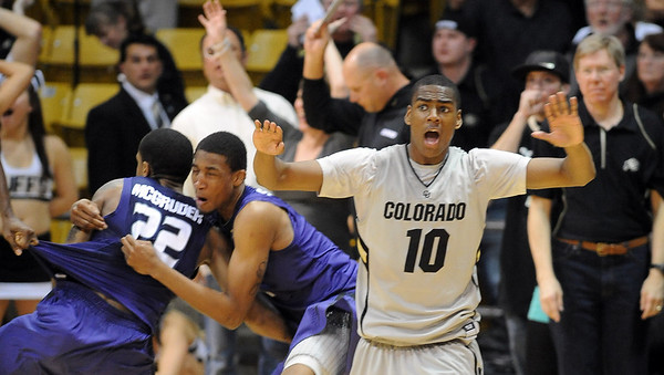 "Alec Burks, right, of Colorado, waves off an apparent game winner by Rodney McGruder (22) of Kansas State.<br /> For more photos of the CU game, go to  <a href=""http://www.dailycamera.com"">http://www.dailycamera.com</a>.<br /> Cliff Grassmick / February 12, 2011"
