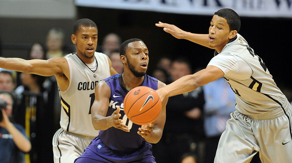 "Jacob Pullen of Kansas State is pressured by Cory Higgins, left, and Andre Roberson, both  of Colorado, during the February 12, 2011 game in Boulder.<br /> For more photos of the CU game, go to  <a href=""http://www.dailycamera.com"">http://www.dailycamera.com</a>.<br /> Cliff Grassmick / February 12, 2011"