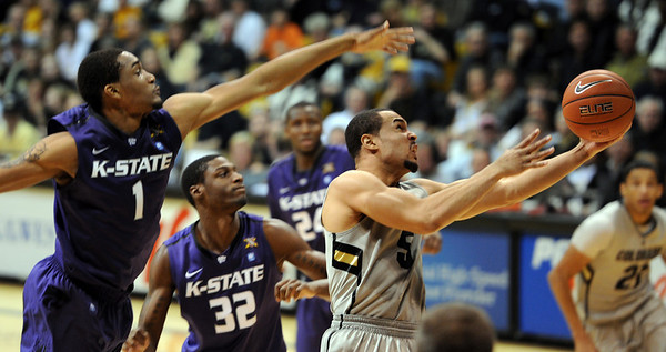 "Marcus Relphorde of CU goes under Shane Southwell of KSU to score in the CU win.<br /> For more photos of the CU game, go to  <a href=""http://www.dailycamera.com"">http://www.dailycamera.com</a>.<br /> Cliff Grassmick / February 12, 2011"