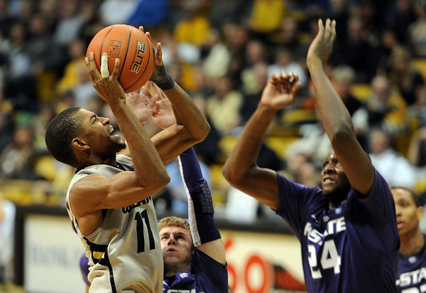 """Cory Higgins of CU tries to score on Curtis Kelly of KSU.<br /> For more photos of the CU game, go to  <a href=""""http://www.dailycamera.com"""">http://www.dailycamera.com</a>.<br /> Cliff Grassmick / February 12, 2011"""