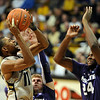 "Cory Higgins of CU tries to score on Curtis Kelly of KSU.<br /> For more photos of the CU game, go to  <a href=""http://www.dailycamera.com"">http://www.dailycamera.com</a>.<br /> Cliff Grassmick / February 12, 2011"