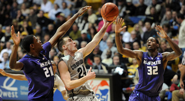 "Levi Knutson of CU scores late in the game against Kansas State.<br /> For more photos of the CU game, go to  <a href=""http://www.dailycamera.com"">http://www.dailycamera.com</a>.<br /> Cliff Grassmick / February 12, 2011"
