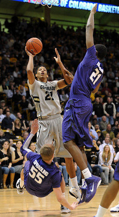 """Andre Roberson of Colorado drives the lane on Will Spradling (55) and Jordan Henriquez-Roberts, both of Kansas State during the first half of the February 12, 2011 game in Boulder.<br /> For more photos of the CU game, go to  <a href=""""http://www.dailycamera.com"""">http://www.dailycamera.com</a>.<br /> Cliff Grassmick / February 12, 2011"""