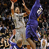 "Andre Roberson of Colorado drives the lane on Will Spradling (55) and Jordan Henriquez-Roberts, both of Kansas State during the first half of the February 12, 2011 game in Boulder.<br /> For more photos of the CU game, go to  <a href=""http://www.dailycamera.com"">http://www.dailycamera.com</a>.<br /> Cliff Grassmick / February 12, 2011"