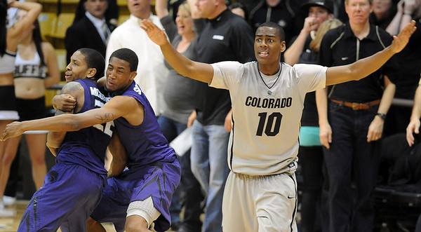 """Alec Burks, right, of Colorado, waves off an apparent game winner by Rodney McGruder (22) of Kansas State.<br /> For more photos of the CU game, go to  <a href=""""http://www.dailycamera.com"""">http://www.dailycamera.com</a>.<br /> Cliff Grassmick / February 12, 2011"""