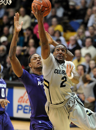 """Shannon Sharpe of CU  drives in to score against KSU.<br /> For more photos of the CU game, go to  <a href=""""http://www.dailycamera.com"""">http://www.dailycamera.com</a>.<br /> Cliff Grassmick / February 12, 2011"""