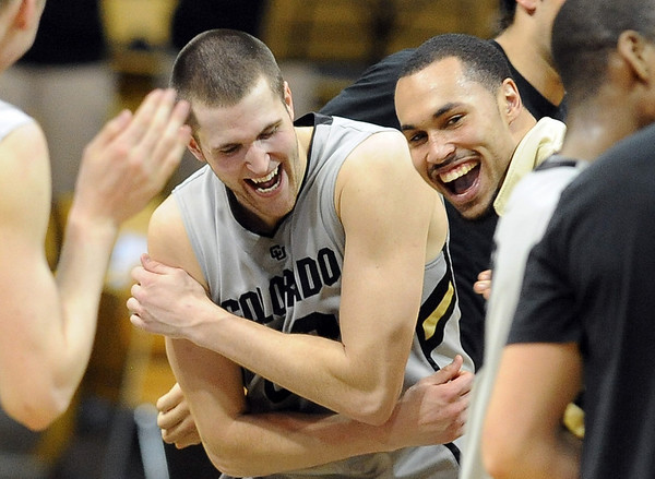 """Austin Dufault, left, and Marcus Relphorde, celebrate CU's win over Kansas State on Saturday.<br /> For more photos of the CU game, go to  <a href=""""http://www.dailycamera.com"""">http://www.dailycamera.com</a>.<br /> Cliff Grassmick / February 12, 2011"""