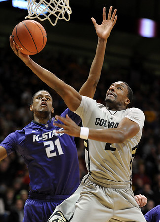 """Shannon Sharpe of Colorado scores past Jordan Henriquez-Roberts in the first half of the February 12, 2011 game in Boulder.<br /> For more photos of the CU game, go to  <a href=""""http://www.dailycamera.com"""">http://www.dailycamera.com</a>.<br /> Cliff Grassmick / February 12, 2011"""