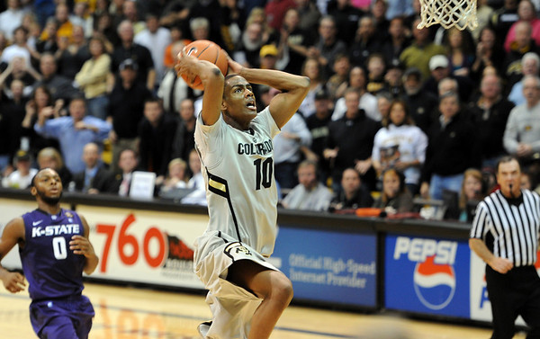 """Alec Burks got a steal and a dunk late in the game against Kansas State.<br /> For more photos of the CU game, go to  <a href=""""http://www.dailycamera.com"""">http://www.dailycamera.com</a>.<br /> Cliff Grassmick / February 12, 2011"""