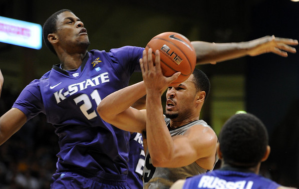 """Marcus Relphorde, right, of Colorado, drives to get past Jordan Henriquez-Roberts of Kansas State during the first half of the February  12, 2011 game in Boulder.<br /> For more photos of the CU game, go to  <a href=""""http://www.dailycamera.com"""">http://www.dailycamera.com</a>.<br /> Cliff Grassmick / February 12, 2011"""