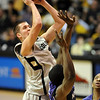 Austin Dufault of CU puts in a shot and one against KSU on Saturday.<br /> <br /> Cliff Grassmick / January 16, 2010