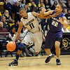 Cory HigginsU  bounces off Rodney McGruder of KSU  on his way to the basket.<br /> <br /> Cliff Grassmick / January 16, 2010
