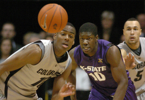 "Alec Burks, left, of CU, Victor Ojeleye of KSU and Marcus Relphorde of CU, watch a loose ball on Saturday.<br /> For more photos of the game, go to  <a href=""http://www.dailycamera.com"">http://www.dailycamera.com</a>.<br /> <br /> Cliff Grassmick / January 16, 2010"