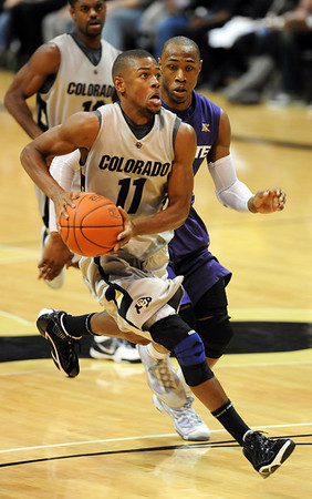 "Cory Higgins of CU  gets a steal and break away lay up past Dominique Sutton of KSU. For more photos of the game, go to  <a href=""http://www.dailycamera.com"">http://www.dailycamera.com</a>.<br /> Cliff Grassmick / January 16, 2010"