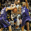 "Cory Higgins of Colorado splits the defense of Denis Clemente, left, and Rodney McGruder of Kansas State on Saturday.<br /> For more photos of the game, go to  <a href=""http://www.dailycamera.com"">http://www.dailycamera.com</a>.<br /> Cliff Grassmick / January 16, 2010"