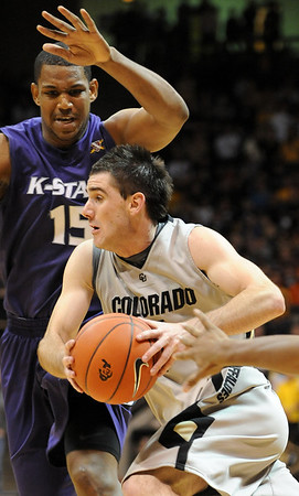 Nate Tomlinson  of CU drives past Luis Colon of KSU.<br /> Cliff Grassmick / January 16, 2010