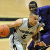 "Marcus Relphorde of CU drives past  Curtis Kelly of KSU.<br />  For more photos of the game, go to  <a href=""http://www.dailycamera.com"">http://www.dailycamera.com</a>.<br /> Cliff Grassmick / January 16, 2010"
