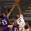 "Brittany Spears of Colorado, knocks the ball from Jalana Childs of Kansas State on Wednesday.<br /> For more  photos of the game, go to  <a href=""http://www.dailycamera.com"">http://www.dailycamera.com</a>.<br /> Cliff Grassmick / March 3, 2010"