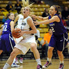 Alyssa Fressle of Colorado drives past Brittany Chambers of Kansas State during the first half of the March 3, 2010 game in Boulder.<br /> Cliff Grassmick / March 3, 2010