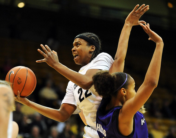 "Brittany Spears of Colorado flips up a shot on Jalana Childs of Kansas State.<br /> For more  photos of the game, go to  <a href=""http://www.dailycamera.com"">http://www.dailycamera.com</a>.<br /> Cliff Grassmick / March 3, 2010"