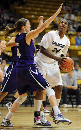 "Courtney Dunn of Colorado looks for room on Ashley Sweat of Kansas State.<br /> For more  photos of the game, go to  <a href=""http://www.dailycamera.com"">http://www.dailycamera.com</a>.<br /> Cliff Grassmick / March 3, 2010"