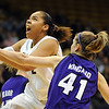 "Bianca Smith of Colorado drives past Kari Kincaid of Kansas State on Wednesday.<br /> For more  photos of the game, go to  <a href=""http://www.dailycamera.com"">http://www.dailycamera.com</a>.<br /> Cliff Grassmick / March 3, 2010"