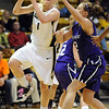 "Alyssa Fressle of Colorado drives past Taelor Karr of Kansas State.<br /> For more  photos of the game, go to  <a href=""http://www.dailycamera.com"">http://www.dailycamera.com</a>.<br /> Cliff Grassmick / March 3, 2010"