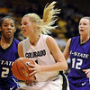 "Alyssa Fressle of Colorado  drives past Mariah White of Kansas State on Wednesday.<br /> For more  photos of the game, go to  <a href=""http://www.dailycamera.com"">http://www.dailycamera.com</a>.<br /> Cliff Grassmick / March 3, 2010"
