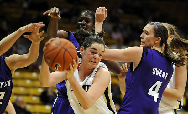 "Meagan Malcolm-Peck of CU gets an offensive rebound in KSU traffic.<br /> For more  photos of the game, go to  <a href=""http://www.dailycamera.com"">http://www.dailycamera.com</a>.<br /> Cliff Grassmick / March 3, 2010"