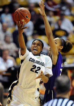 "Brittany Spears of CU scores past Jalana Childs of KSU.<br /> For more  photos of the game, go to  <a href=""http://www.dailycamera.com"">http://www.dailycamera.com</a>.<br /> Cliff Grassmick / March 3, 2010"