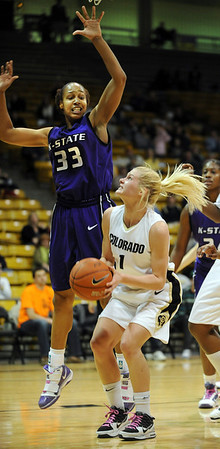 "Alyssa Fressle of Colorado gets Jalana  Childs of Kansas State up in the air before scoring.<br /> For more  photos of the game, go to  <a href=""http://www.dailycamera.com"">http://www.dailycamera.com</a>.<br /> Cliff Grassmick / March 3, 2010"