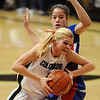 Alyssa Fressle of Colorado drives past Monica Engelman of Kansas.<br /> Cliff Grassmick / February 16, 2010