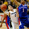 Bianca Smith of Colorado drives to the past around Aishah Sutherland of Kansas.<br /> Cliff Grassmick / February 18, 2010