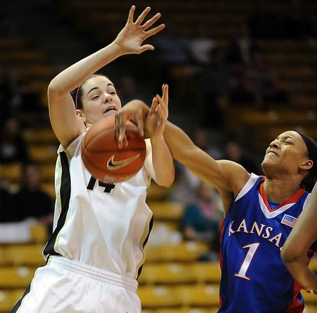 Aishah Sutherland, right, of Kansas, knocks the ball from Meagan Malcolm-Peck of Colorado during the first half of the February 16, 2010 game in Boulder.<br /> Cliff Grassmick / February 16, 2010