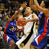 Bianca Smith of Colorado drives between Sade Morris (20) and Aishah Sutherland, both of Kansas, during the first half of the February 16, 2010 game in Boulder.<br /> Cliff Grassmick / February 16, 2010