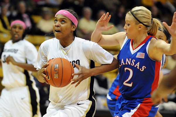 Brittany Spears of Colorado drives past Kelly Kohn of Kansas on Tuesday.<br /> Cliff Grassmick / February 16, 2010